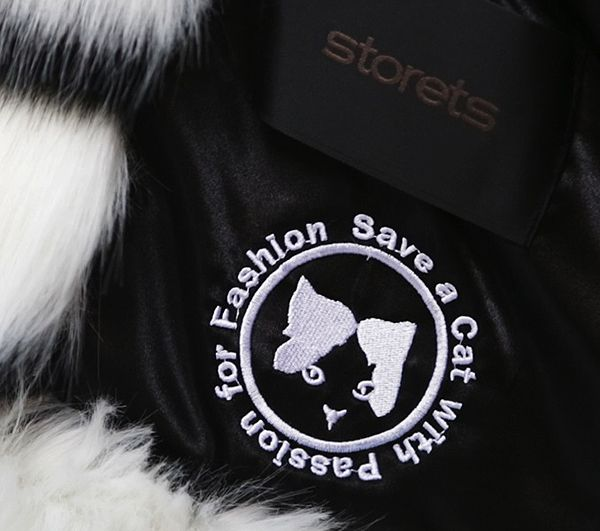 The faux fur coat features a special logo. Photo by Storets