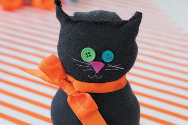 A cute cat sock doll you can make yourself. Photography courtesy Frog Prince Paperie blogger Paula Biggs.